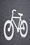 Bicycle road. Detail of bicycle sign on asphalt road Royalty Free Stock Images