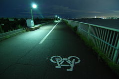 Bicycle road. Night image of bicycle road going faraway on the Tokyo bay embankment Stock Photo