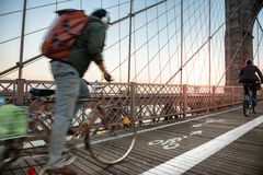 Bicycle road with cyclist on Brooklyn Bridge in New York City Stock Image