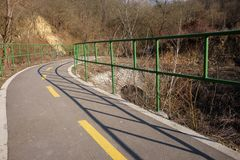 Bicycle road with green handrails.  Royalty Free Stock Image