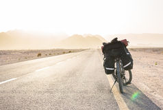 Bicycle on road in Istael desert. Beautiful Israel nature and road with low traffic Royalty Free Stock Photo