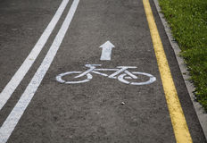 Bicycle road with sign. And arrow Royalty Free Stock Image