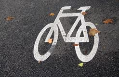 Bicycle road sign. Painted on asphalt Royalty Free Stock Photography