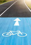Bicycle road sign and arrow on bicycle Lanes. In Park, selective focus Royalty Free Stock Image