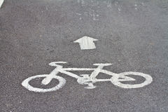 Bicycle road sign and arrow Stock Images