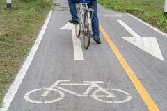 Bicycle road sign on asphalt. Leisure activities Stock Image