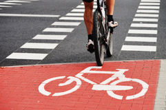 Bicycle road sign and bike rider Stock Photos