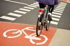 Bicycle road sign and bike rider Stock Images