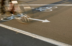 Bicycle road sign and bike rider in motion Royalty Free Stock Images