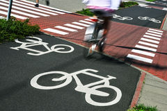 Bicycle road sign and bike riders Stock Photos