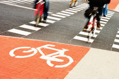 Bicycle road sign and bike riders Stock Photo
