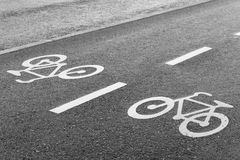 Bicycle Road Sign Double Lane. On Wet Tarmac Stock Images