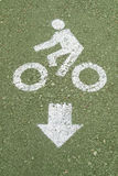 Bicycle road sign on green floor Stock Image
