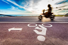 Bicycle road sign with motion blur of motorcycle Stock Images