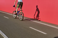 Bicycle road sign and part of bike rider Stock Images