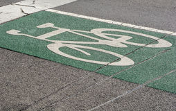 Bicycle road sign on the pavement Royalty Free Stock Image