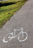 Bicycle road sign. On sidewalk stock photos