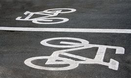 Bicycle road signs. Painted on asphalt Royalty Free Stock Images