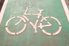 Bicycle road signs on the road Stock Images