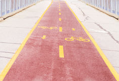 Bicycle Road With Yellow Signs Royalty Free Stock Images