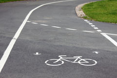 Bicycle roadsign. Bicycle route sign on the road and arrows pointing direction Stock Photos