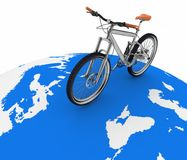 Bicycle rolling on the globe Stock Photography