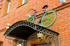 A bicycle on the roof. Bright street photography, porch institutions, bicycle, bright lights Stock Photography