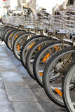 Bicycle in a row in the street Stock Image
