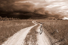 Bicycle on rural road. Old bicycle on rural road Stock Photos