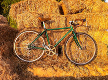 Bicycle on rural straw landscape image with Silhouette  morning. Light and vintage Royalty Free Stock Photo