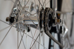 Bicycle's detail view of rear wheel with chain & sprocket Royalty Free Stock Image