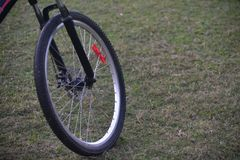Bicycles tyre on a grass field stock image