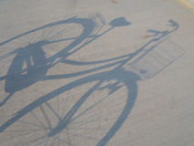 Bicycle's shadow Stock Photography