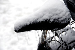 Bicycle saddle, icicles and snow Royalty Free Stock Photos