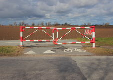 Bicycle Safety Barrier in Stripes and Bike Sign on Rural Road Royalty Free Stock Photography