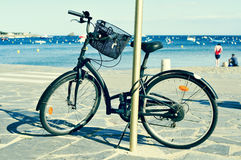 Bicycle in a seafront on the Mediterranean sea, with a filter ef Royalty Free Stock Images