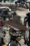 Bicycle seat. Weather beaten bicycle seat seen during a walk through town Stock Image