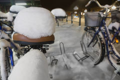 Bicycle seat with snow Royalty Free Stock Photos