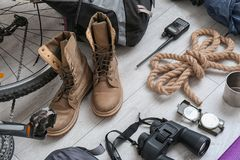 Bicycle and set of camping equipment. On wooden floor stock images