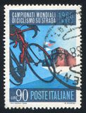 Bicycle and Sforza Castle in Imola. ITALY - CIRCA 1968: stamp printed by Italy, shows Bicycle and Sforza Castle in Imola, circa 1968 stock photos