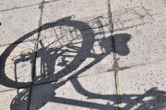 Bicycle shadow. Of parking bike Stock Photos