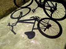 Bicycle shadow on ground Royalty Free Stock Photo