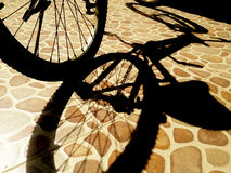 Bicycle shadow on ground Royalty Free Stock Photography