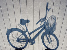 Bicycle shadow on Wooden floor Art abstract background Stock Image