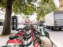 Bicycle share bicycles lined up on London sidewalk Royalty Free Stock Photos