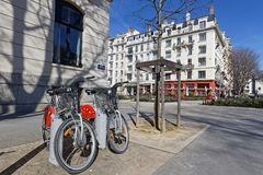 Bicycle sharing system in Brotteaux district of Lyon. LYON, FRANCE, March 22, 2018 : Bicycle sharing system, in front the ancient railway station of Lyon Stock Photos