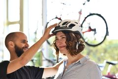 Bicycle shop consulting - customer tests a bicycle helmet for road safety. Closeup photo stock photo