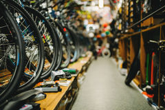 Bicycle shop, rows of new bikes, cycle sport store. Bicycle shop, rows of new bikes. Equipment and accessories for cycles. Sport store Stock Photos