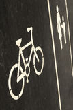 Bicycle and sidewalk sign on the road Stock Images