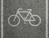 Bicycle sign on asphalt. In backgrounds Stock Images
